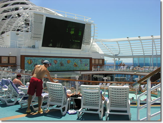 Top of the ship with the huge tv screen over the pool